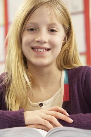 non uniform: Schoolgirl Studying In Classroom