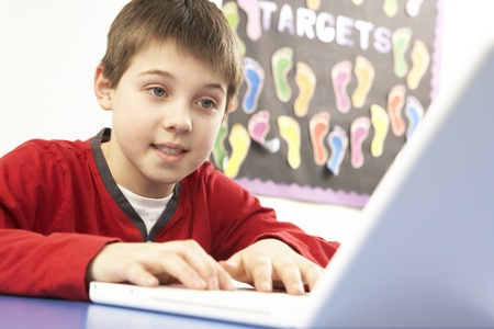 nine year old: Schoolboy In IT Class Using Computer