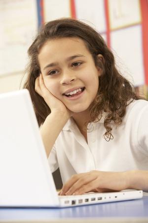 9 year old: Schoolgirl In IT Class Using Computer Stock Photo