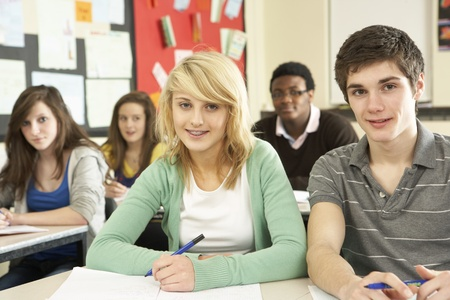 Teenage Students Studying In Classroom photo