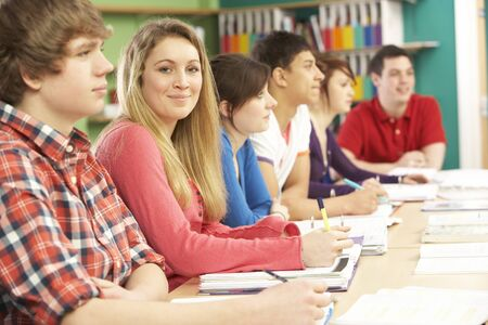 Teenage Students Studying In Classroom Stock Photo - 9911900