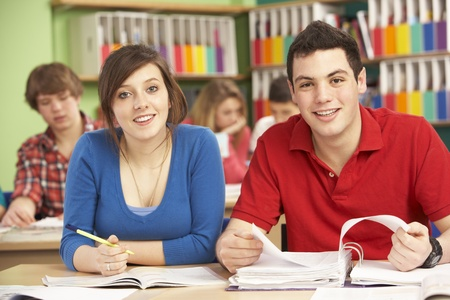 Teenage Students Studying In Classroom Stock Photo - 9911976