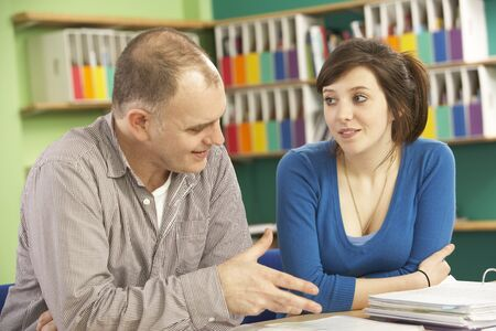 Teenage Student In Classroom With Tutor photo
