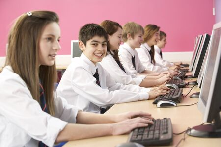 Teenage Students In IT Class Using Computers In Classroom photo