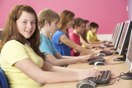 non uniform: Teenage Students In IT Class Using Computers In Classroom Stock Photo