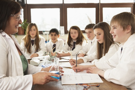 Group Of Teenage Students In Science Class With Tutor Stock Photo - 9911535