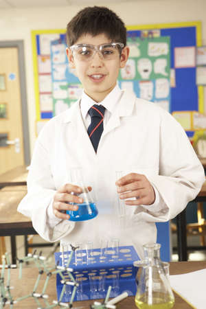 Male Teenage Student In Science Class With Experiment photo