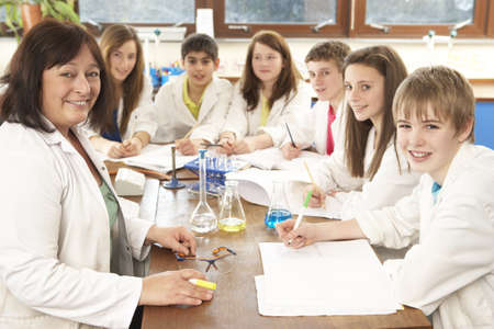 Group Of Teenage Students In Science Class With Tutor Stock Photo - 9911333