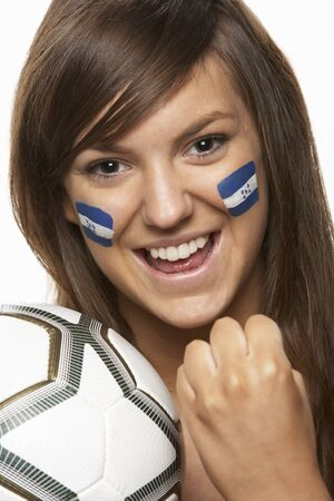 Young Female Sports Fan With Honduras Flag Painted On Face photo