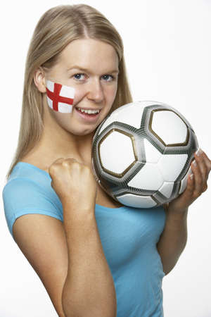 Young Female Sports Fan With St Georges Flag Painted On Face photo