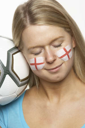 Young Female Football Fan With St Georges Flag Painted On Face photo