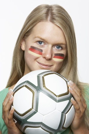 Young Female Sports Fan With German Flag Painted On Face photo