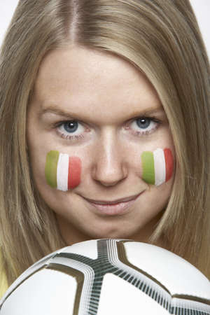 Young Female Sports Fan With Italian Flag Painted On Face photo