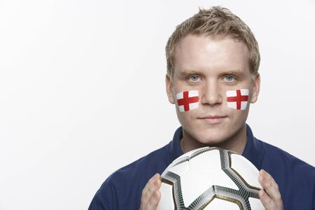 Young Male Football Fan With St Georges Flag Painted On Face photo
