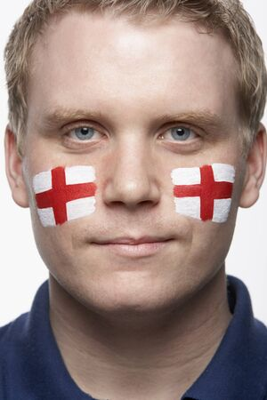 Young Male Sports Fan With St Georges Flag Painted On Face photo