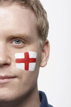 georges: Young Male Sports Fan With St Georges Flag Painted On Face Stock Photo