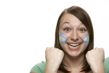 argentinian flag: Young Female Sports Fan With Argentinian Flag Painted On Face Stock Photo