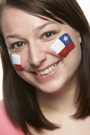 Young Female Sports Fan With Chilean Flag Painted On Face photo