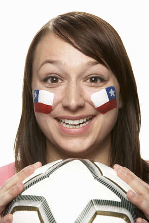Young Female Football Fan With Chilean Flag Painted On Face photo