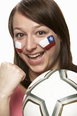bandera chilena: Joven aficionado al f�tbol femenino con bandera chilena pintada en la cara Foto de archivo