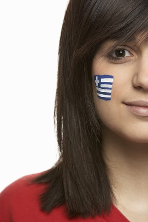 painted face: Young Female Sports Fan With Greek Flag Painted On Face