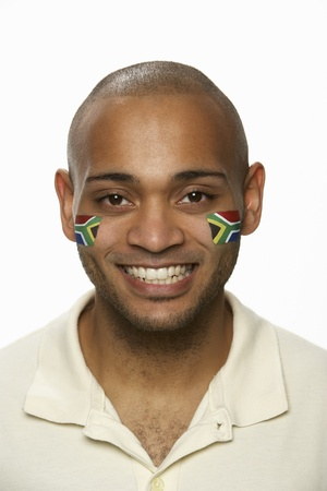 south african: Young Male Sports Fan With South African Flag Painted On Face Stock Photo