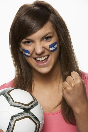Young Female Football Fan With Honduran Flag Painted On Face photo