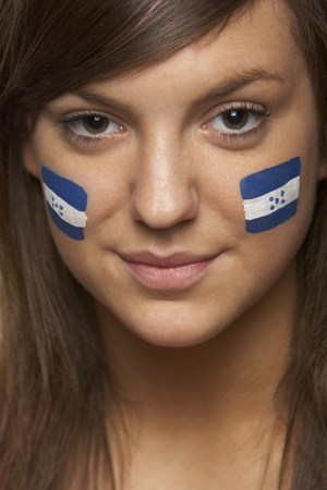Young Female Sports Fan With Honduran Flag Painted On Face photo