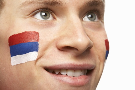 Young Male Football Fan With Serbian Flag Painted On Face photo