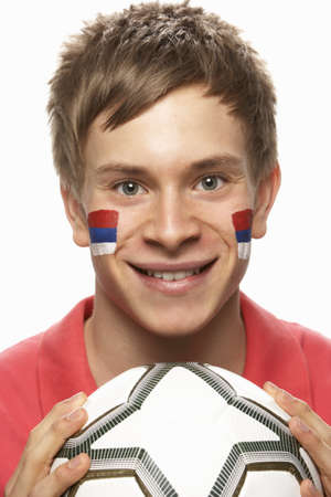 serbian: Young Male Football Fan With Serbian Flag Painted On Face