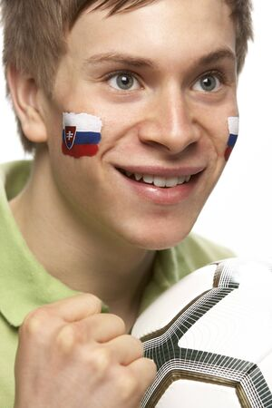 Young Male Football Fan With Slovakian Flag Painted On Face photo