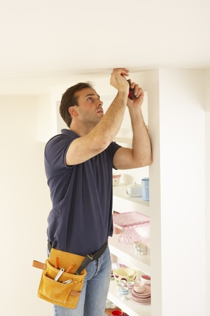 Electrician Installing Light Fitting In Home Stock Photo - 9911795