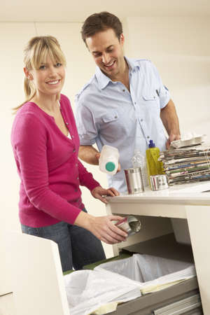 Couple Recyling Waste At Home photo