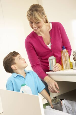 Mother And Son Recyling Waste At Home photo