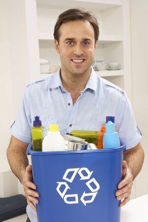 recycle bin: Man Holding Recyling Waste Bin At Home