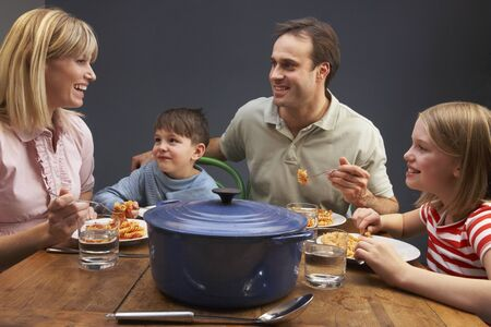 Family Enjoying Meal Together At Home photo