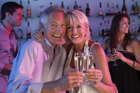 Senior Couple Having Fun In Busy Bar Stock Photo - 9911257
