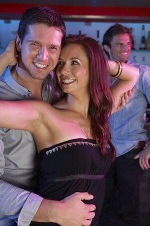 Couple Having Fun In Busy Bar photo