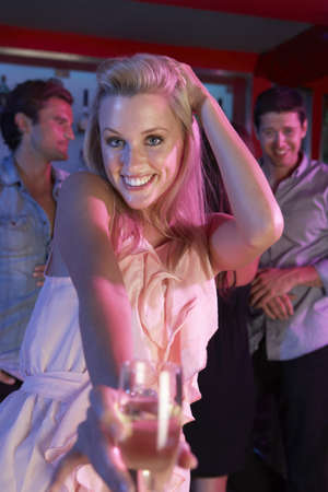Young Woman Having Fun In Busy Bar photo