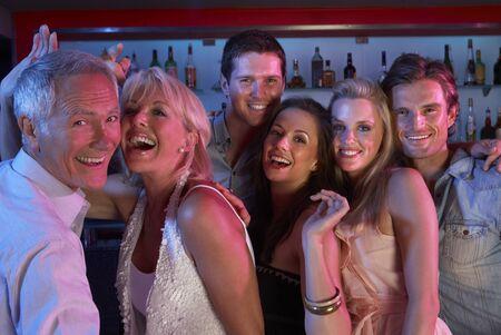 people  dancing: Group Of People Having Fun In Busy Bar