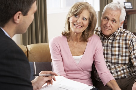 Senior Couple Talking With Financial Advisor