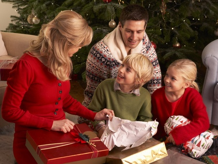 Family Opening Christmas Gifts At Home Stock Photo - 85423922