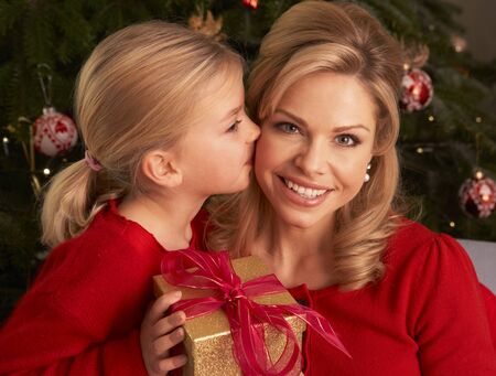 Daughter Giving Mother Christmas Gift Imagens