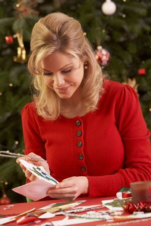 Woman Making Christmas Cards At Home