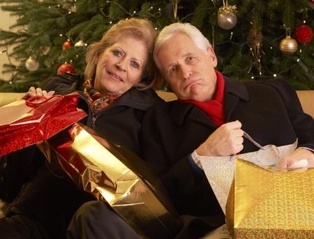 Senior Couple Returning After Christmas Shopping Trip Stock Photo