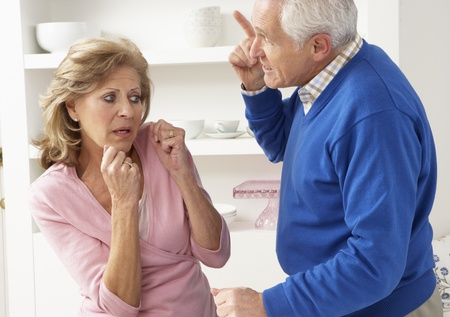 Senior Couple Having Argument At Home Stock Photo