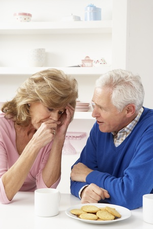 Senior Man Consoling Wife Stock Photo