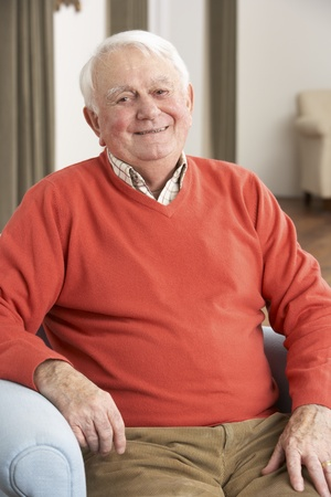 Senior Man Relaxing In Chair At Home Stock Photo - 9911139