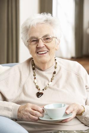 Senior Woman Enjoying Cup Of Tea At Home Stock Photo - 9911410