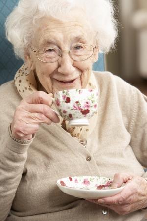 Senior Woman Enjoying Cup Of Tea At Home Stock Photo - 9911169